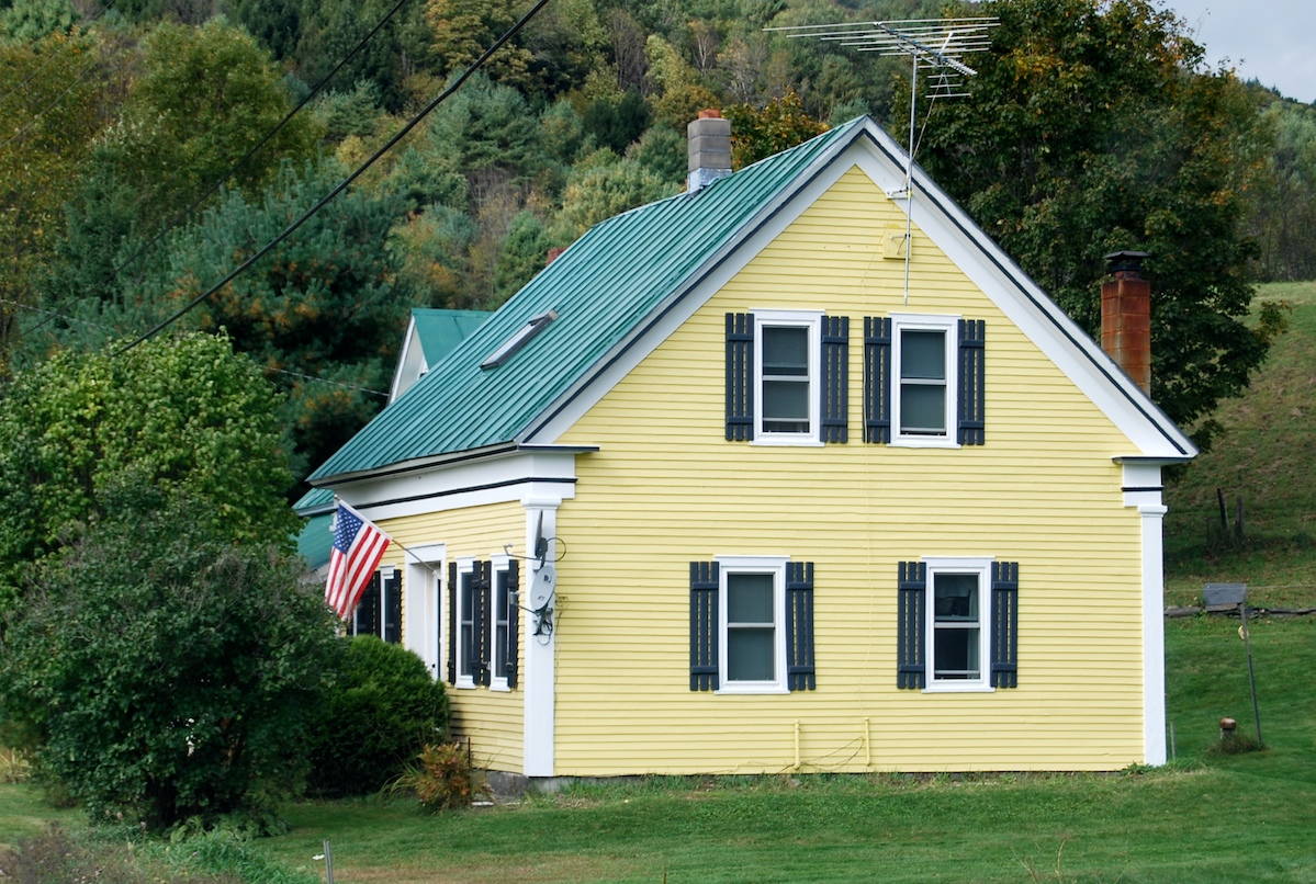 How Would Design Guidelines Or Regulations Deal With This Problem We Have The Clic New England House Yellow Paint And Green Roof Then